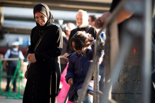 A young migrant girl and mother are relieved after arriving in Munich.