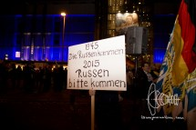 """Sign demanding Russia to step in and """"help"""" the German government in 2015."""