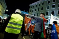 Participant carrying a Turkish flag forming his hands to the 'wolve' - sign of the Turkish 'Grey Wolve' facists.
