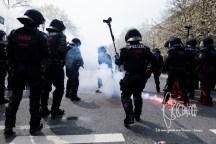 Neo-nazis launch pyrotechnics on police.