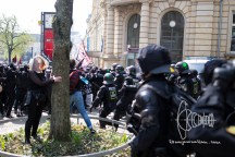 Antifacist activists try to leave demonstration to reach neonazi route - riot police uses batons to push back protestors.