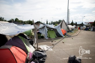 Emptied out tents, in the background school for refugees and medical facilities.