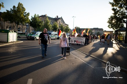 """PEGIDA starts so called """"walk"""". Fuerth inhabitants let down shutters as the group walks by."""