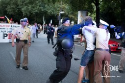 Single antifascist activist in front of PEGIDA march gets violently removed by police.