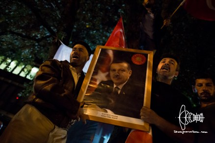 Erdogan portrait held up front.