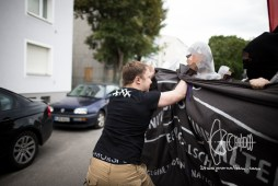 Participant of AfD election-party pushes into demonstration.