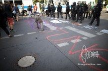 "Chalk-spraypaint on the floor saying ""Ministry of Exploitation"""