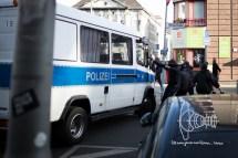 Activist attacks police-car.
