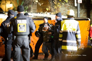 Activist evicted from tree almost collapses while taken in custody.