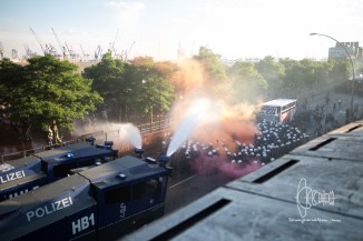 Water cannons in use against demonstrators