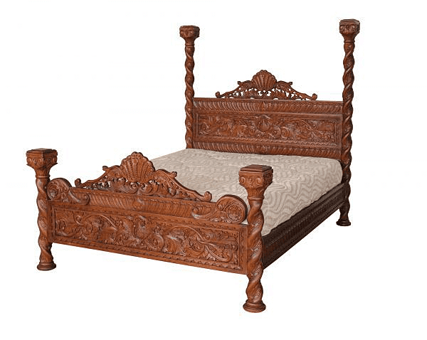 ornate four poster bed in mahogany
