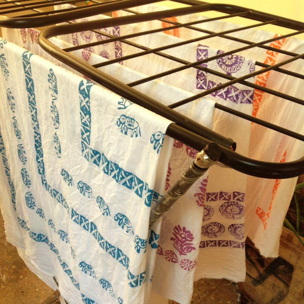 These are hand printed fabrics on cloth stand, left for drying