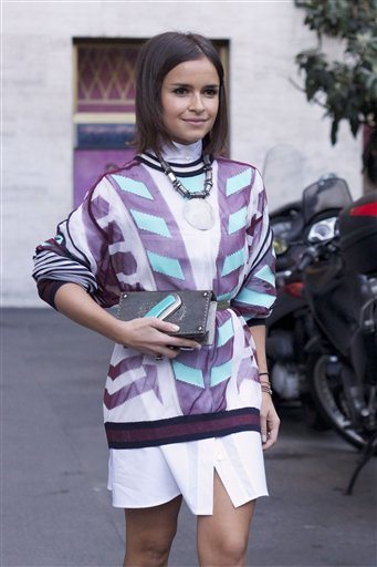 Old street style picture of Mira at Milan Fashion Week in September 2012.