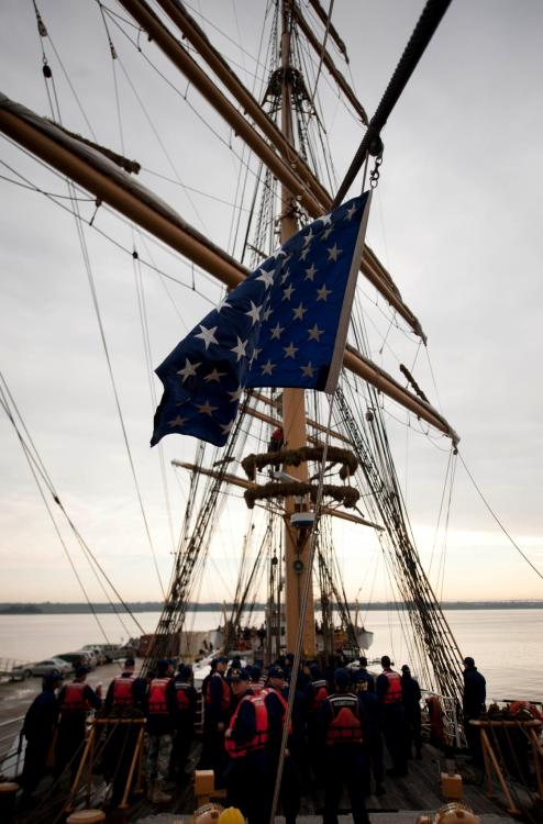 Eagle crewmembers, officer candidates, and boatswain's mate A-school students await orders at the fore mast. We pulled away from the pier just a few minutes ago. Eagle is officially underway, heading north to our homeport of New London. (via FaceBook)