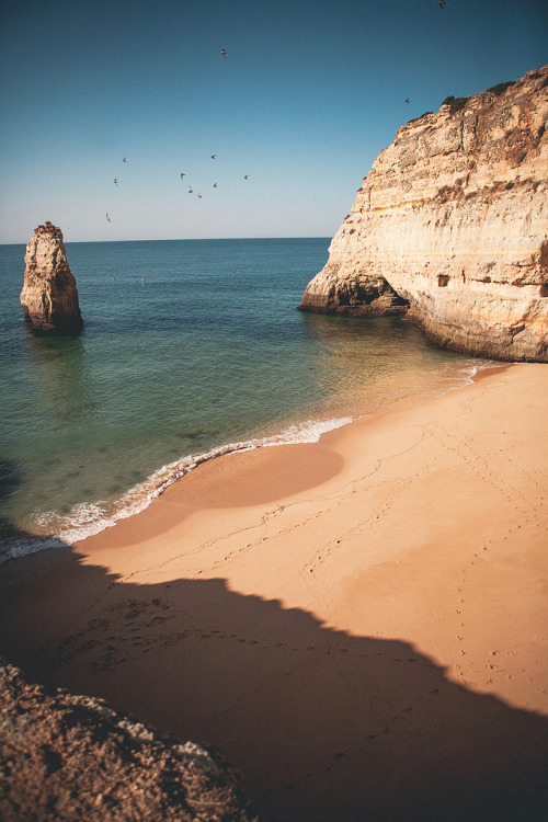 brutalgeneration:</p> <p>Carvalho beach (by N+T*)</p> <p>A nice quiet place to perchance dream.<br /> Lie in the soft sand,<br /> Gaze up at the bright sun,<br /> Feel the soft sand beneath my fingers.<br /> Oh no!<br /> My mind wakes up.<br /> It starts churning with weird ideas.<br /> Is there a shadow from someone<br /> Hiding behind that rock?<br /> Or are those footsteps I hear in the sand<br /> Approaching me from behind?<br /> How do we turn off our minds and relax?<br /> I guess some people just can't.