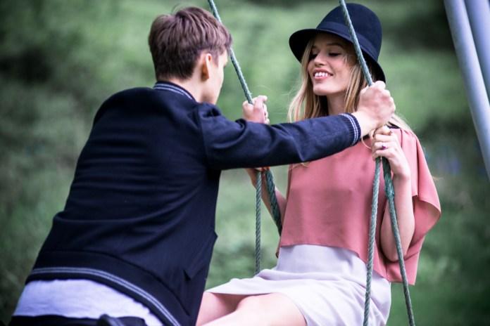 Two lovers on a swing. Georgia May Jagger and Josh McLellan for Sisley Live campaign.