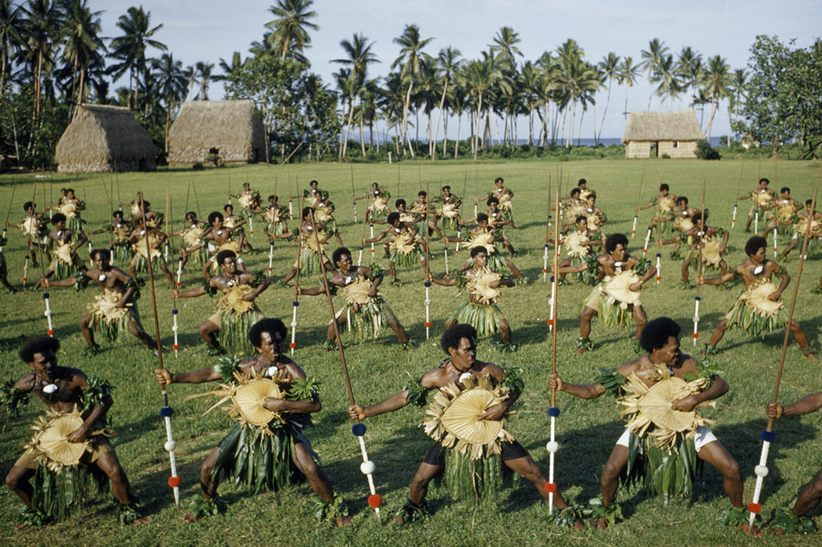 Dancing men brandish spears and palm-leaf shields in Fiji, November 1958. PHOTOGRAPH BY LUIS MARDEN, NATIONAL GEOGRAPHIC