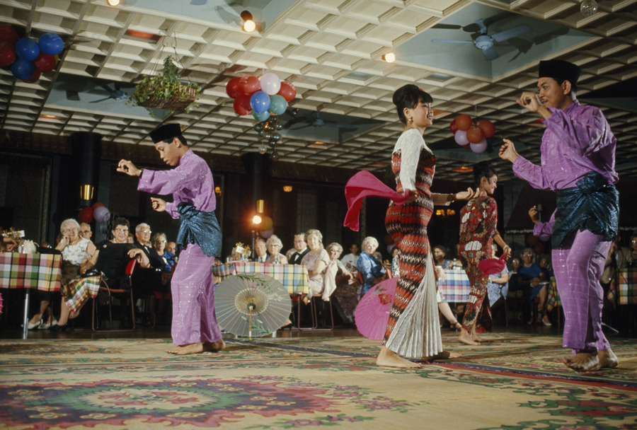 Malays in traditional dress dance for guests at the Raffles Hotel in Singapore, August 1966.Photograph by Winfield Parks, National Geographic