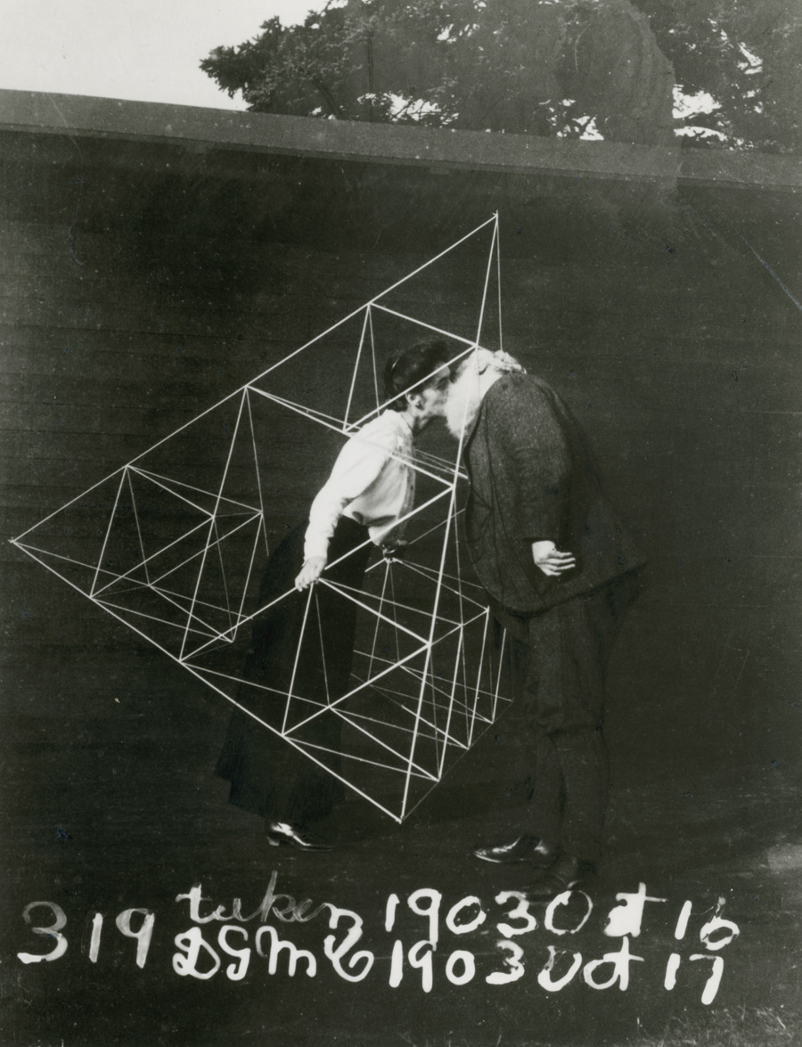 Alexander Graham Bell and Mabel kissing within a tetrahedral kite, October 1903.Photograph courtesy Library of Congress