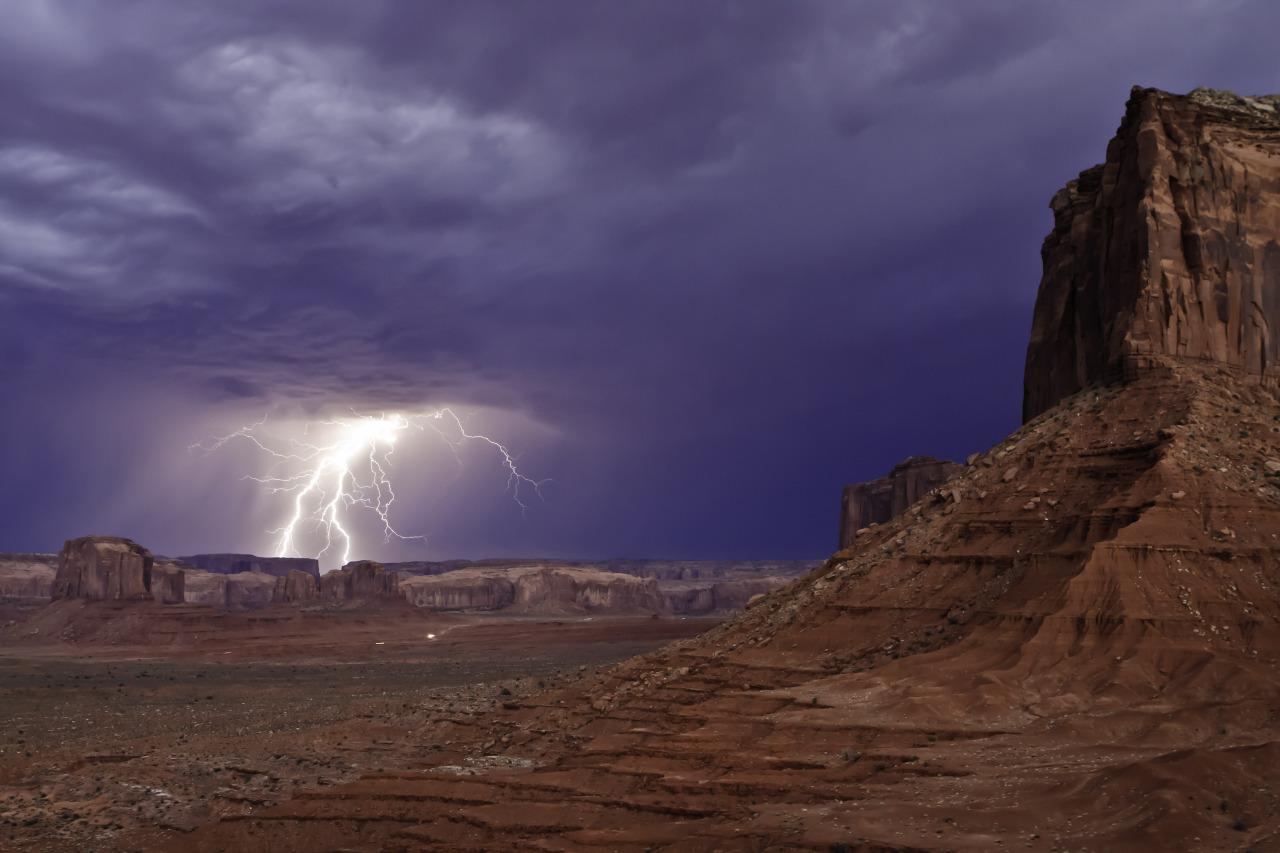 Lightning strikes in Monument Valley, on the Navajo Reservation, Utah.  Photography by Carolyn Slay (Oak Ridge, TN); Monument Valley, UT