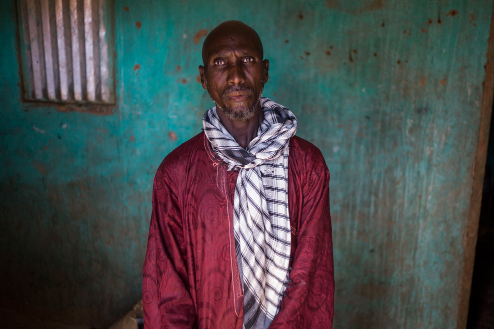 Idrissa Maiga, a Malian farmer, poses in his house in Konna on January 27, 2013. Maiga's second wife, 41, and two boys and a girl aged from 10 to 14 perished during a French army air raid and were buried the same afternoon. (Fred Dufour/AFP/Getty Images)