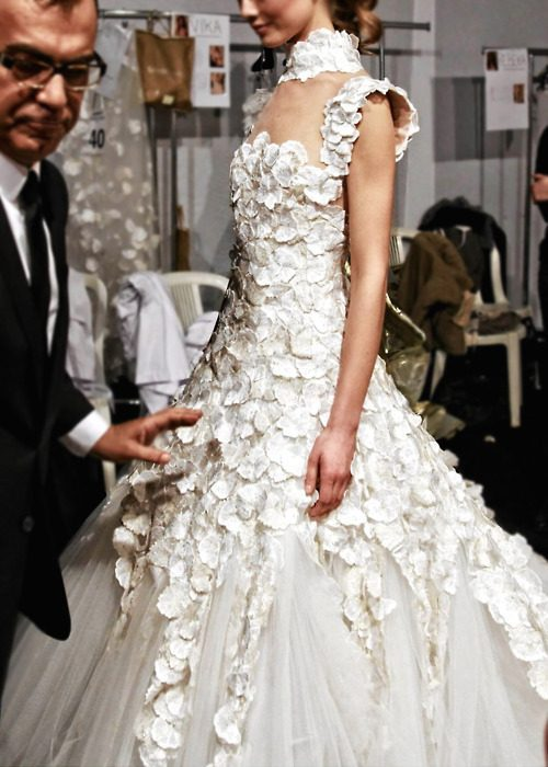 Notice the tall neckline. Look for more of this in next year's wedding dress designs.