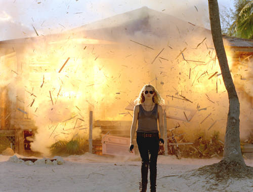 Teresa Palmer walking away from an explosion (in I Am Number Four)