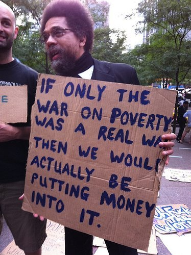Dr. Cornell West at the Occupy Wall Street protest. True story painted on that sign…