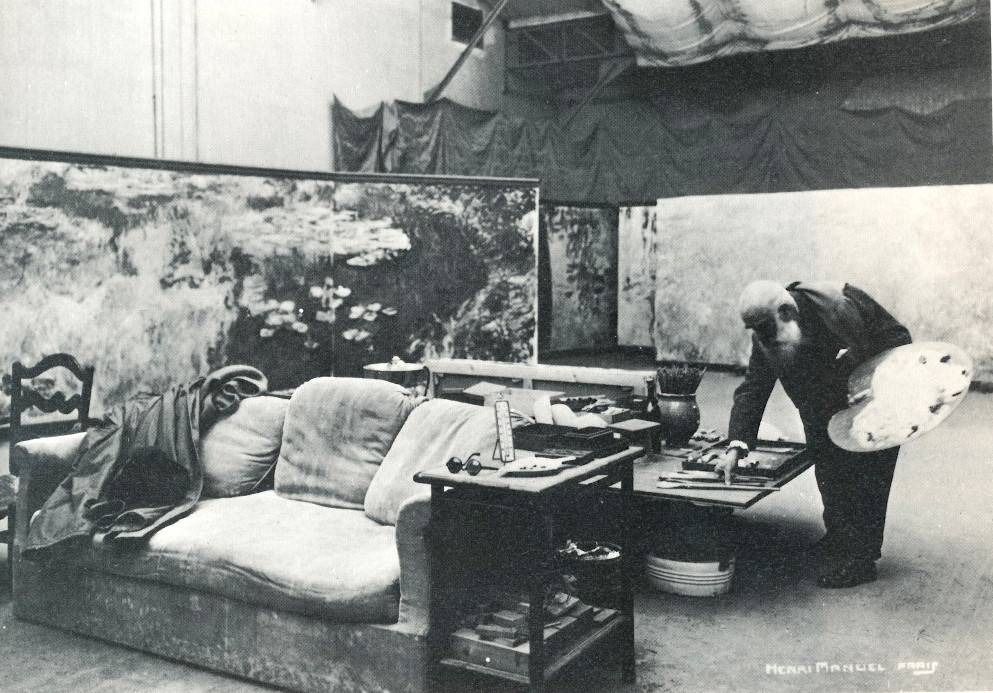 Claude Monet in his third studio, surrounded by panels of his large Water Lilies series, 1920s. Photo by Henri Manuel, collection of the Musee Marmottan, Paris.