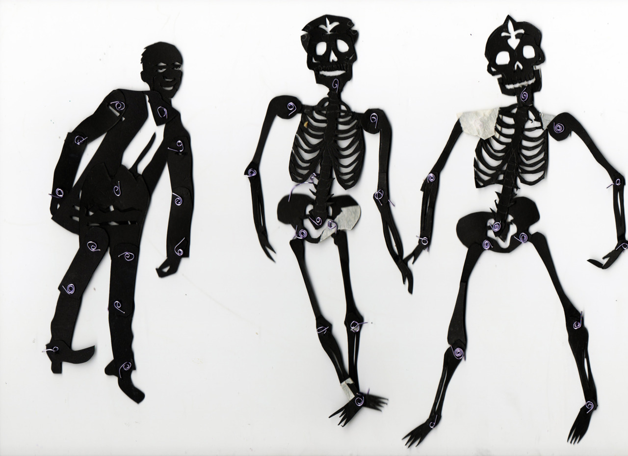 Silhouette puppets used for an animation based on the word TRANSFER. The theme is based on the Mexican Day of the Dead.