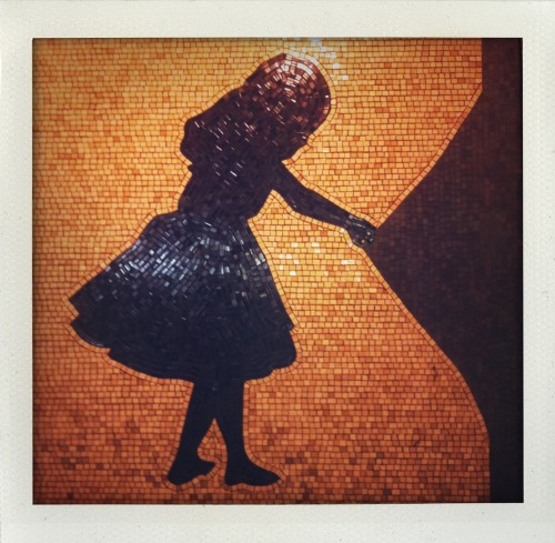 More from The Way Out by Liliana Porter at the 50th Street 1 train subway station. Alice even looks behind the tiles at the train station, cause you know, she's curious like that. Maybe she's trying to find her unlimited metrocard?<br /> Photography by Ruddy Harootian