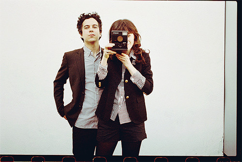 She & Him (Zooey Deschanel & M. Ward) with a polaroid