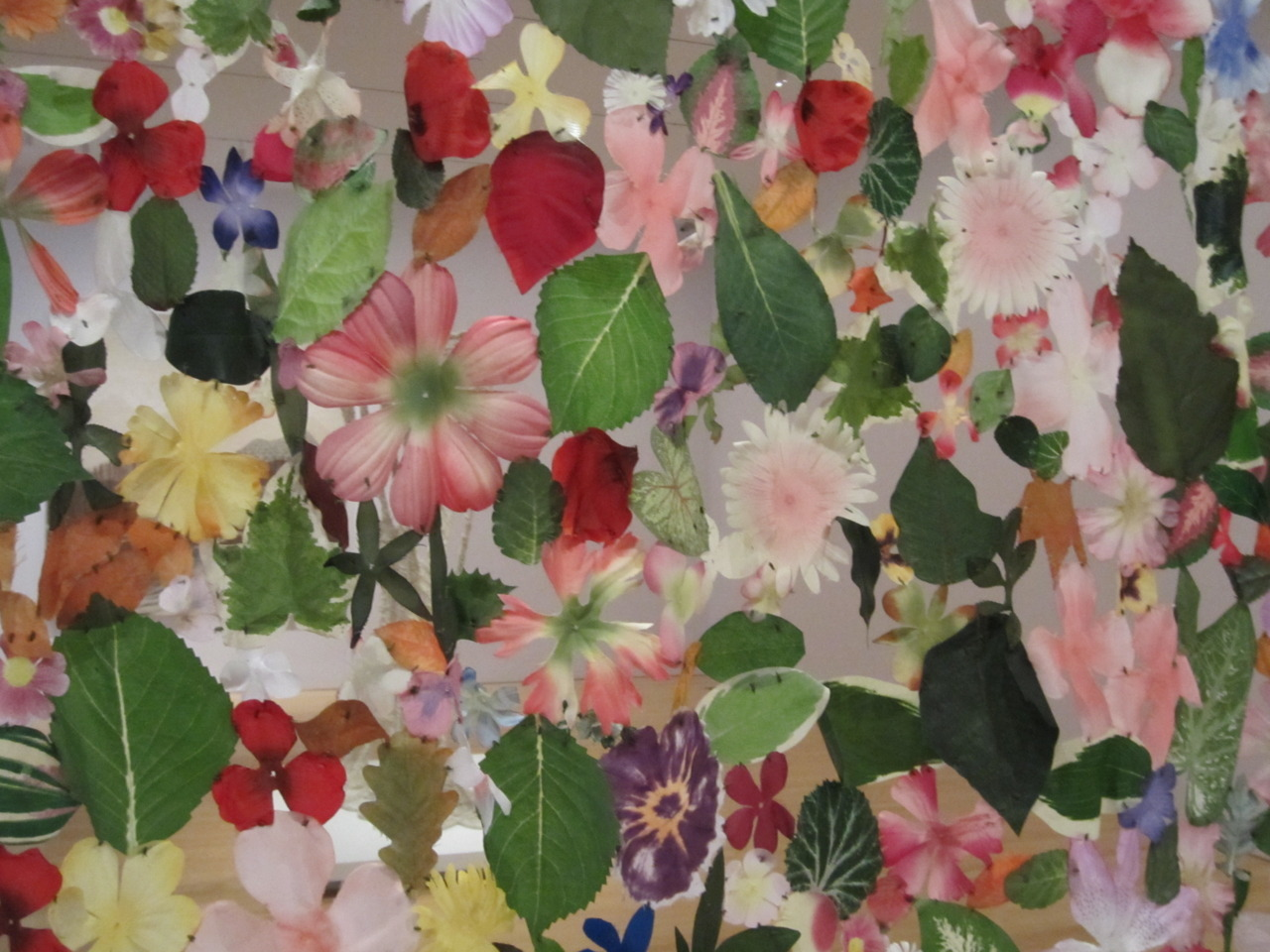 "A close-up of Jim Hodges' 'Every Touch', a breathtaking curtain of hundreds of artificial flowers meticulously sewn together.on view in ""Secret Garden"", Perelman Building"