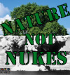 "Samantha Hurley ""Nature Not Nukes"" The background of the work is the ""Tree-and-mushroom cloud"" photograph. Green stencil-text reads ""Nature Not Nukes"""