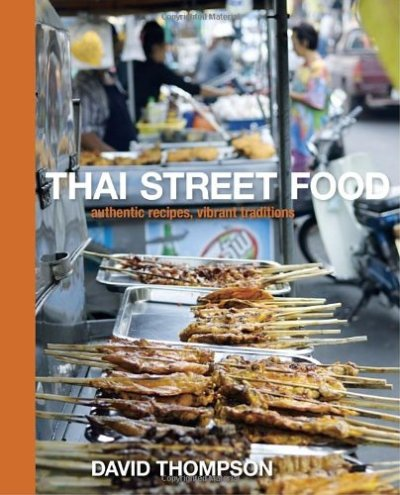 "Thai Street Food David Thompson Thai Street Food transports readers straight into the bustling heart of Thailand's colorful street stalls and markets—from the predawn rounds of monks fanning out along the aisles to the made-to-order stalls ablaze in neon and jammed with hungry locals after dark. Featuring nearly 100 authentic dishes plus lavish photography accompanying every recipe, this stunning cookbook is the definitive guide to Thailand's culinary street culture. The recipes, such as Steamed Fish with Chilli and Lime Sauce, Pork Satay, Roast Duck and Egg Noodle Soup, and Sweet Banana Roti illuminate the beguiling world of food so integral to the Thais.   Scholar and chef David Thompson lives with a singular passion for Thailand's customs, culture, and people. Although he claims ""It's all about the food,"" this ambitious work shares his insights into the rhythms and nuances of Thai daily life along with a fascinating history of its richly diverse street cuisine. This cookbook is a tempting, inspiring, and authoritative account of Thai street food, the vibrant culinary mosaic rich with community."