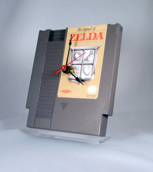NES clocks  This geeky clock is manufactured from an original NES cartridge, mounted to a recycled acrylic stand. The clock features black hands and a quartz motor. The clock stands 51/4 inches high by 41/2 wide.  Buy here.