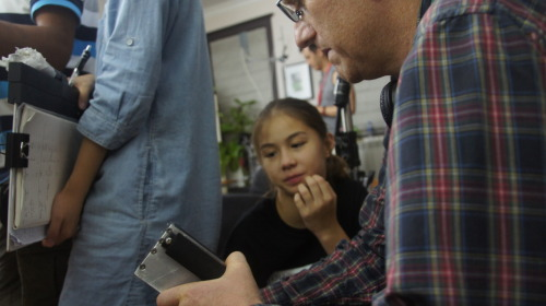 Lead Actress Sofie Fella, 12, speaks with director Richard Trombly on the set. Analysishttp://www.obscure-productions.com/analysis.html was shot on location in Shanghai China in August 2012.