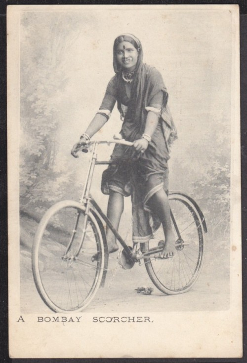 vintageindianclothing:A Bombay Scorcher. Is that the bicycle or the bicycle?!This was of course a saucy postcard as opposed to being taken on the streets of Bombay while this barefoot lass was going about her day's business. Her smile is sweet, her sari is tied Maharashtrian style (maybe just tuck away that falling pleat?!) and her blouse is cute and snug with a glimpse of decolletage. And she has blouse armband jewellery. Win.