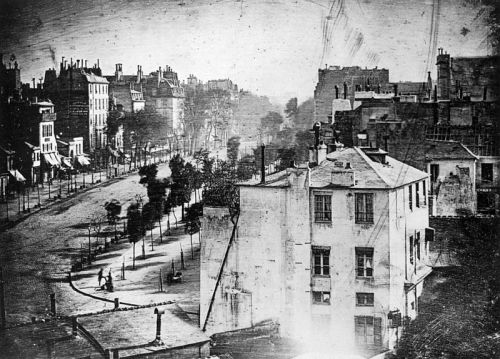 The oldest known photograph of a person, 1838 – a Parisian getting his shoes shined. It was taken in the middle of a busy street, but because the exposure time was over 10 minutes, the moving traffic wasn't captured. Because the man stood still long enough to have his boots polished, he was captured in the daguerreotype.