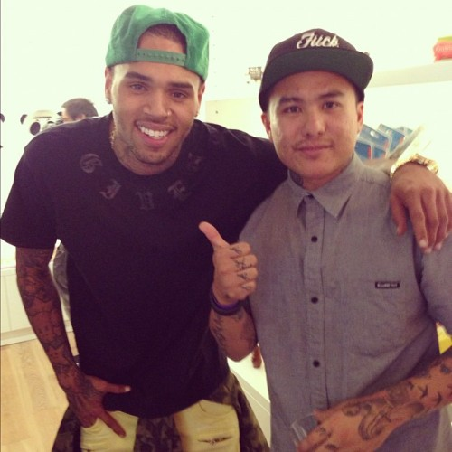 Chris Brown and fan during the Wild Style Grand Opening last night