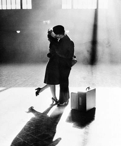 Mary Rae Bingham kisses her boyfriend, Gordon Kiester, in the sunshine from a window at Michigan Central Station in Detroit, December 28, 1944. Kiester is about to return to his duties as a sailor after a Christmas holiday break.