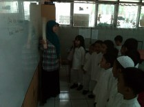She (Ms. Yayah) reads and the pupils followed her.