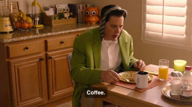 Cooper sits at breakfast table with his tie wrapped over his head and says 'coffee'