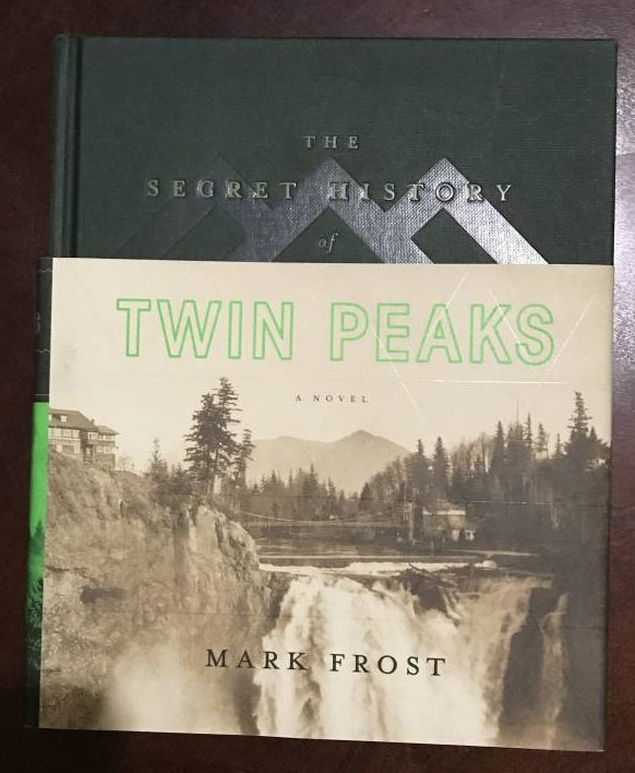 The front cover of The Secret History of Twin Peaks is a green book with a dustover image of the Great Bothern Falls in sepiatone