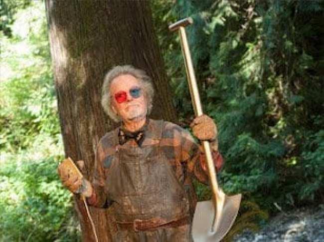 Dr Jacoby holds a golden shovel