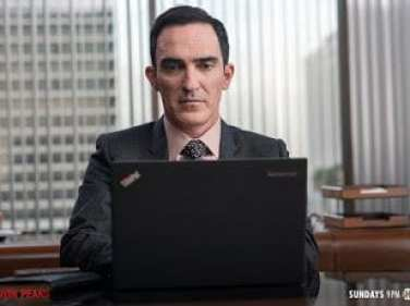 Mr Todd types on a laptop in Twin Peaks