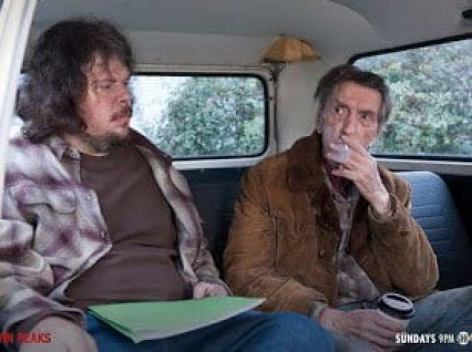 Carl Rodd and Mickey in a van