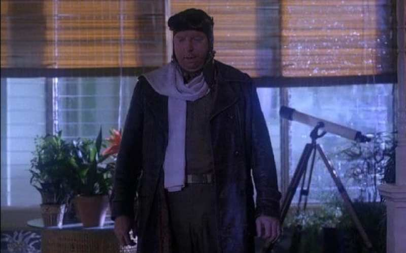 Major Briggs returns from his abduction dressed in 1920s pilot wear