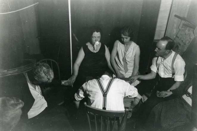 A seance where the medium allegedly exhibits ectoplasm