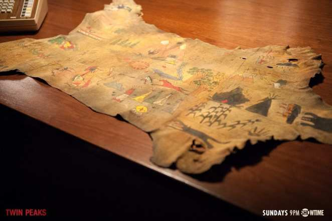 a Native American map with many symbols painted on it